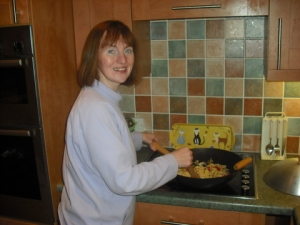 Julie Calder often cooks tasty ultra healthy food with a wok.  Her family benefits from eating right too.  Photograph taken March 2009.  (P.S.  Notice how cute Julie looks--a good diet does that!)
